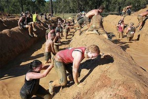 photo of Tough Mudders Moving Through the Mud Mile